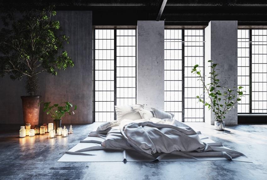 Ungemachtes Matratzenlager in einem Loft